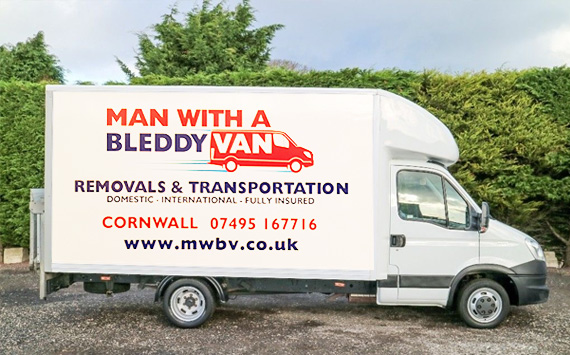 One of our vans parked up by a tall hedgerow for removals in Helston